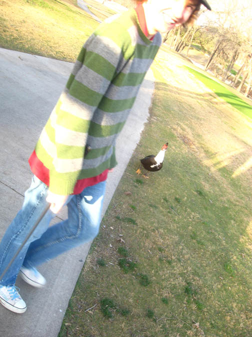 ryland and a duck on the golf course... i love this picture.