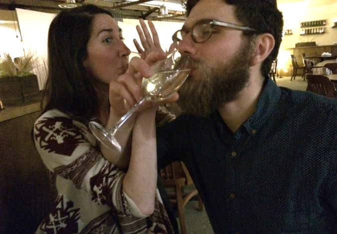 trying to drink champagne AND show off the ring at the same time. I'm not too proud. WE'RE ENGAGED.